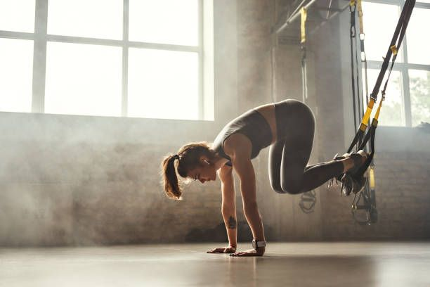 TRX suspended crunch on hands